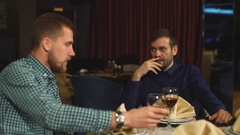Two men on a business dinner, drink wine Stock Footage