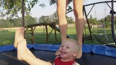 Mom Legs Boy Bounce Smile Trampoline - 4k - Slow motion Stock Footage