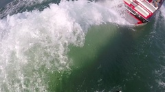 POV of a man wake surfing behind a boat on a lake. Stock Footage