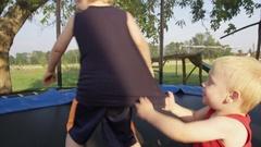 Brothers Goofy Sunny Trampoline - 4k Stock Footage
