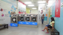 View of self service laundry interrior in china town in KLCC Stock Footage
