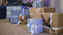 New Year decorations. decorative blue lanterns and gift boxes under fir-tree Stock Footage