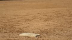 A boy runs to first base at little league baseball practice. Stock Footage