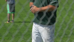 A coach is coaching boys at little league baseball practice. Stock Footage