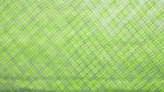 A green grass field through a chain link fence. Stock Footage