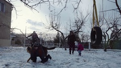 Family plays with snow in sunny winter day Stock Footage