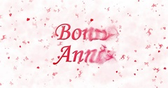 "Happy New Year text in French ""Bonne annee"" turns to dust from bottom on white Stock Footage"