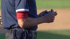 The umpire at a baseball game with his score notepad. Stock Footage