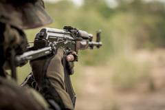 Marine aiming from machine gun Stock Photos