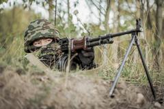 Soldier aiming from machine gun Stock Photos