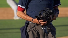 The umpire with a safety face mask at a baseball game. Stock Footage