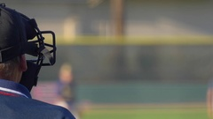 The umpire with a safety face mask at a baseball game, slow motion. Stock Footage