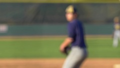 The pitcher at a baseball game throws the ball to the batter, slow motion. Stock Footage