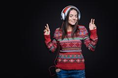 Meditative young woman listening to the music and dancing Stock Photos