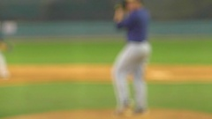A batter at a baseball game prepares to swing the bat and hit the ball, slow mot Stock Footage