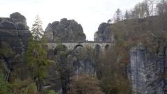 View of Bastei Bridge, rock formation mountain, long shot, Germany Stock Footage