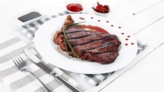 Juicy grilled beef meat steak fillet with marks of bbq Stock Footage