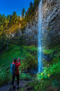 Watson Falls Backpacker in Oregon Stock Photos
