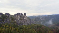 Rock formations, lush green forest, fog mist clouds, Bastei, Germany Stock Footage