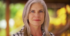 Closeup of mid-aged Caucasian woman looking into camera Stock Footage