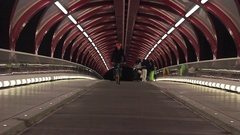 A bmx mountain biker does a trick in an underground train station. Stock Footage