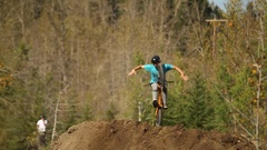 A mountain biker rides on a singletrack trail in the forest, slow motion. Stock Footage