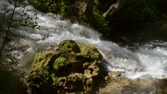River Flows around a Rock Stock Footage