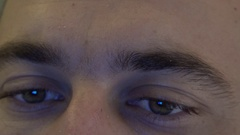 Closeup on man eyeball navigating online on facebook fast moving eyes view 4K Stock Footage