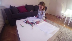 Little girl drawing with crayons at home Stock Footage