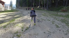 Pov chasing young boy on mountain Stock Footage