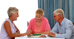 Senior couple playing puzzle Stock Footage