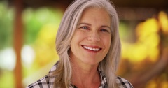 Lovely mature Caucasian woman smiling outside Stock Footage