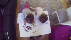 Two little girls drawing with crayons at home Stock Footage