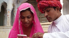 Indian couple having a discussion over a cell phone mobile device  Stock Footage