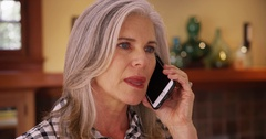 Beautiful mature Caucasian woman talking a cellular handheld device Stock Footage