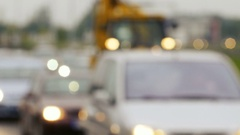 Blurry. unfocused clip of urban traffic. including cars. buses and other Stock Footage