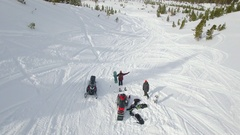 Aerial of a man snowmobiling in the mountains. Stock Footage