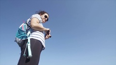 Young female on vacation pointing at something outside of camera view. Stock Footage