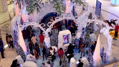 Top shot of people wait in line for taking picture with Santa Claus Stock Footage