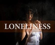 Loneliness written on virtual screen. hand of young woman melancholy and sad at Stock Photos