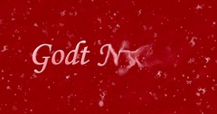 "Happy New Year text in Norwegian ""Godt nyttar"" turns to dust from bottom on red Stock Footage"