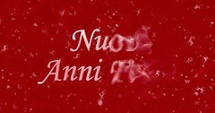 "Happy New Year text in Italian ""Nuovi anni felici"" turns to dust from bottom on Stock Footage"