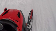 POV of a man snowmobiling in the mountains, time-lapse. Stock Footage