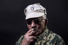 Old man with glasses and camouflage Stock Photos