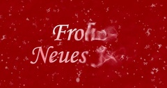 """Happy New Year text in German """"Frohes neues Jahr"""" turns to dust from bottom on Stock Footage"""
