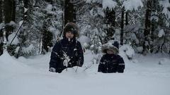 Slow-motion of joyful kids playing in snow, Full HD footage Stock Footage