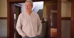 Mature senior white man looking around interior house Stock Footage