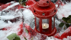 Festive red candle in lantern with snow Stock Footage