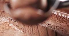 Chocolate ice cream in scoop closeup focus pull Stock Footage