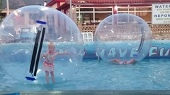 Twins children playing in water balls Stock Footage